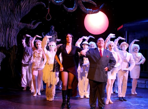 """Morticia and Gomez tango in """"The Addams Family."""" (Photo by John B. Barrois)"""