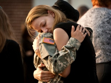 Kerry Cahill is comforted at the funeral for her father. (Photo by Jay Janner | Austin American-Statesman)